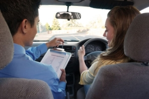 A driver is supervised by an instructor.