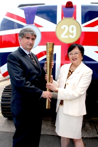 Tom Mullarkey and Catherine Chin with the Olympic Torch