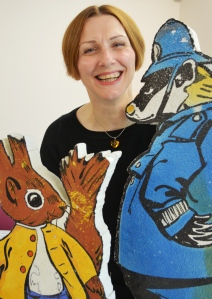 Campaigns officer Helen Halls with Tufty and Policeman Badger