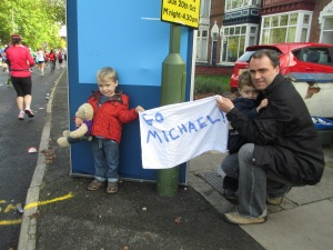 Michael's nephews and brother-in-law show their support at the six-mile mark.