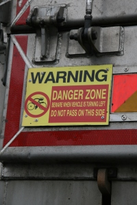 A warning sign has been fitted to the rear nearside corner of all CEMEX haulage vehicles, alerting cyclists to the danger of passing along the inside of the vehicle.